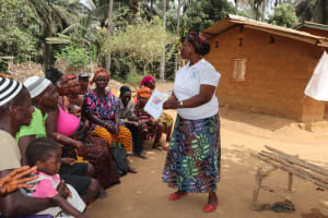 The Water Project: Lokomasama, Gbonkogbonko Village -  Hygiene Facilitator Teaching About Clotheslines