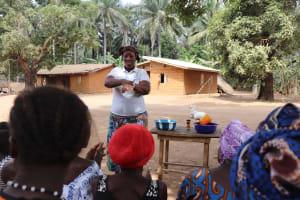 The Water Project: Lokomasama, Gbonkogbonko Village -  Hygiene Facilitator Teaching Proper Way Of Handwashing