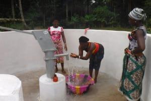 The Water Project: Lokomasama, Gbonkogbonko Village -  Woman Joyfully Looking At Clean Water