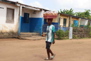 The Water Project: Lungi, Tintafor, Police Barracks E-Line Block 7 -  Boy Selling Food