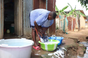 The Water Project: Lungi, Tintafor, Police Barracks E-Line Block 7 -  Boy Laundering