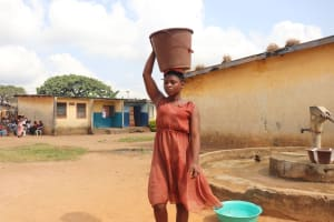 The Water Project: Lungi, Tintafor, Police Barracks E-Line Block 7 -  Girl Carrying Water