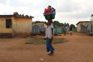 The Water Project: Lungi, Tintafor, Police Barracks E-Line Block 7 -  Woman Selling Plastic Bowls