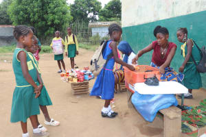 The Water Project: Lungi, Tintafor, Sierra Leone Church Primary School -  Students Buying Food