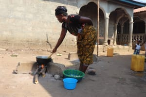 The Water Project: Lungi, Rotifunk, Paramount Chief's Compound -  Woman Cooking