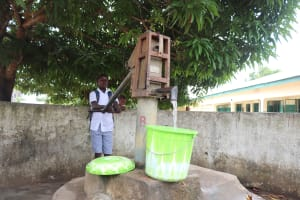 The Water Project: Kankalay Primary and Secondary School -  Student Collecting Water