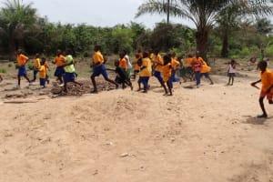 The Water Project: Kamasondo, Masome Village -  Pupils Outside Class