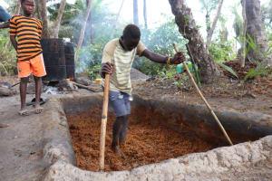 The Water Project: Kamasondo, Masome Village -  Processing Palm Oil