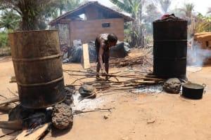 The Water Project: Kamasondo, Masome Village -  Cooking Palm Kernel