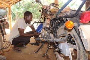 The Water Project: Lokomasama, Bompa Morie Village -  Motorbike Mechanic At Work