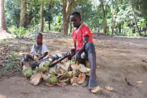 The Water Project: Lokomasama, Bompa Morie Village -  Boy Peeling Coconuts