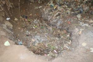 The Water Project: Lokomasama, Bompa Morie Village -  Garbage Pit