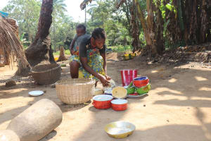 The Water Project: Lokomasama, Bompa Morie Village -  Woman Cleaning Up Dishes