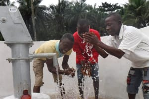 The Water Project: Lokomasama, Gbonkogbonko Village -  Community Members Celebrating Clean Water