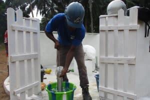 The Water Project: Lokomasama, Gbonkogbonko Village -  Testing Pump Cylinder