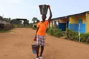 The Water Project: Lungi, Tintafor, Police Barracks E-Line Block 7 -  Boy Carrying Water