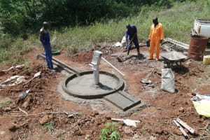 The Water Project: Kinuma Kyarugude Community -  Casting And Installation Of The Apron And Drainage Channel