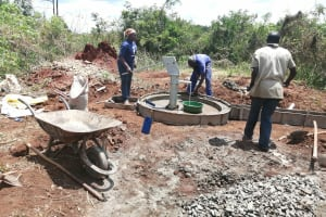 The Water Project: Kinuma Kyarugude Community -  Casting And Installation Of The Apron And Drainage