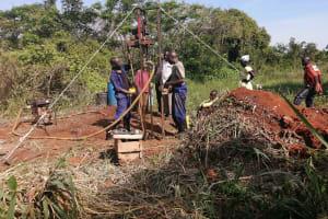 The Water Project: Kinuma Kyarugude Community -  Construction Shallow Well Drilling