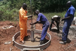 The Water Project: Kinuma Kyarugude Community -  Kinuma Kyarugudde Installation Of The Well