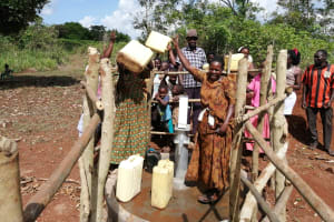 The Water Project: Kinuma Kyarugude Community -  People Celebrating At The Water Point
