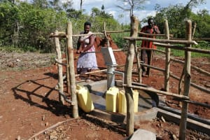 The Water Project: Kinuma Kyarugude Community -  People Collect Water At The Waterpoint