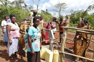 The Water Project: Kinuma Kyarugude Community -  People Collecting Water