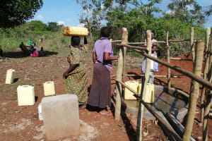 The Water Project: Kinuma Kyarugude Community -  People Collecting Water At The Waterpoint
