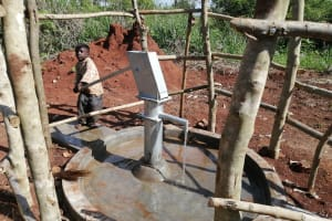 The Water Project: Kinuma Kyarugude Community -  Water Flowing