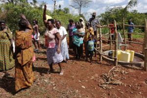 The Water Project: Kinuma Kyarugude Community -  People Dancing And Singing At The Water Point