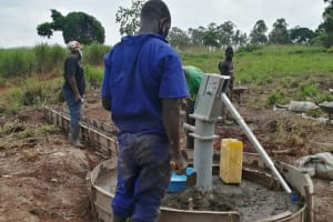 The Water Project: Kaitabahuma I Community -  Finishing The Concrete Work On The Well