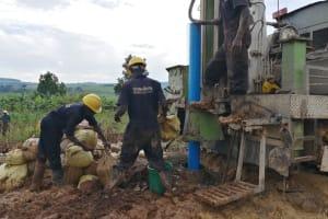 The Water Project: Kaitabahuma I Community -  Installing Pump Casing