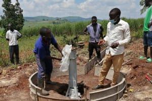 The Water Project: Kaitabahuma I Community -  Installing The Pump