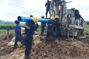 The Water Project: Kaitabahuma I Community -  Pump Casing Installation