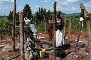 The Water Project: Kaitabahuma I Community -  Women Collect Water