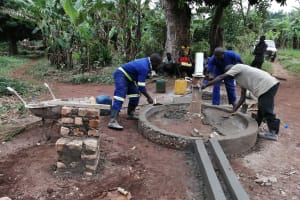 The Water Project: Kabo Village -  Cementing Well Platform