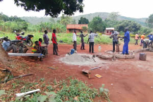 The Water Project: Kabo Village -  Community Assists In Well Rehab