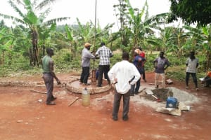 The Water Project: Kabo Village -  Community Assists Well Rehab
