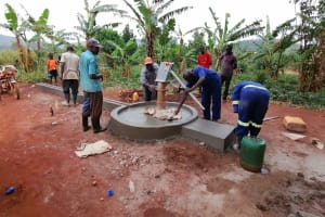 The Water Project: Kabo Village -  Construction Of Well Apron And Drainage Channel