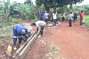 The Water Project: Kabo Village -  Drainage Channel Construction
