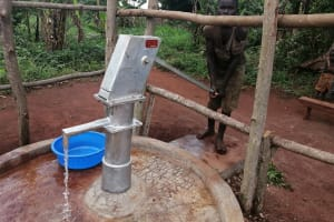 The Water Project: Kabo Village -  Fetching Water From The Rehabilitated Well