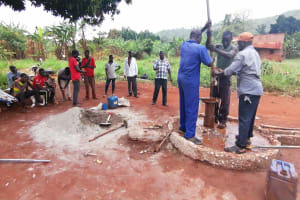 The Water Project: Kabo Village -  Installing Well Casing