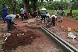 The Water Project: Kabo Village -  Plastering The Apron