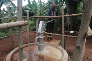 The Water Project: Kabo Village -  Pumping Rehabilitated Well