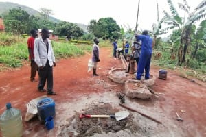 The Water Project: Kabo Village -  Removing Old Well Parts