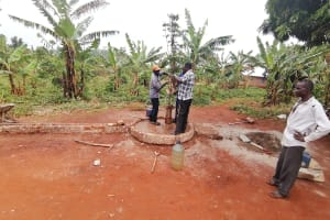 The Water Project: Kabo Village -  Removing Old Well Pump