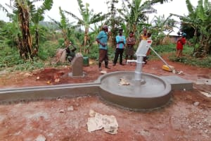 The Water Project: Kabo Village -  Well Cement Dries