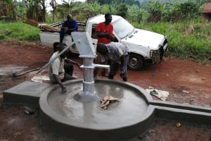 The Water Project: Kabo Village -  Working On Well Cement