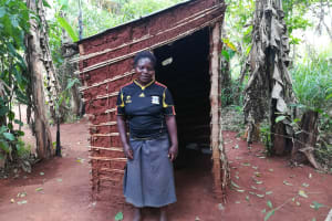 The Water Project: Marongo-Kahembe Community -  Woman Stands At Her Latrine