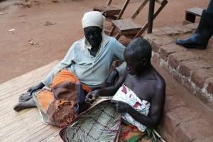 The Water Project: Marongo-Kahembe Community -  Women Making Baskets